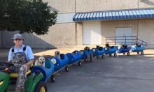 Man Builds Dog Train To Entertain Rescue Dogs He Rescued
