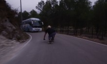 Downhill Skateboarder Has a Very Close Call