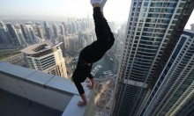 An Unfathomably Stupid Skyscraper Handstand