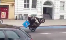 Pizza Delivery Driver Executes Flawless Wheelie Down Road... Then Falls