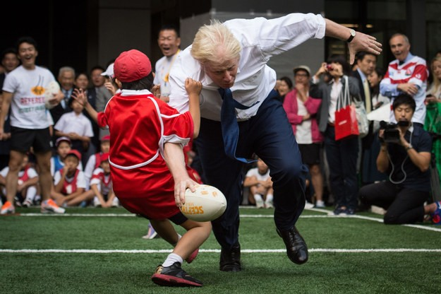 Watch Boris Johnson Truck A Child During Rugby Match