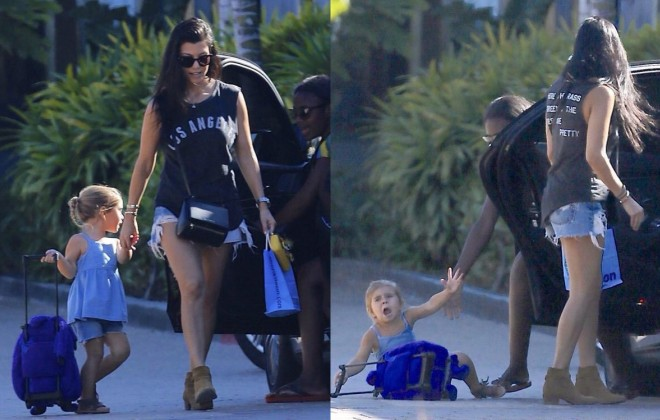 Quality Pics Of A Kardashian Bashing Her Kid With Car Door