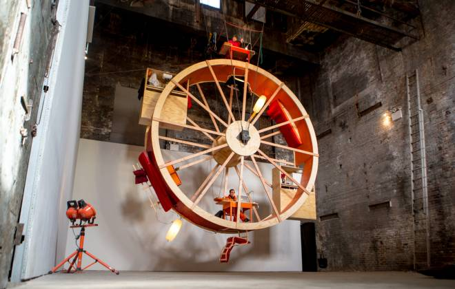 Meet The Two Artists Living in a Giant Hamster Wheel